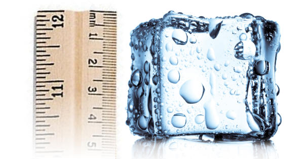 An ruler beside an ice cube, representing the depth of tissue temperature change in cryotherapy.