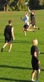 Photograph of me playing ultimate, a sport that has caused many cramps and a few muscle strains over the years.